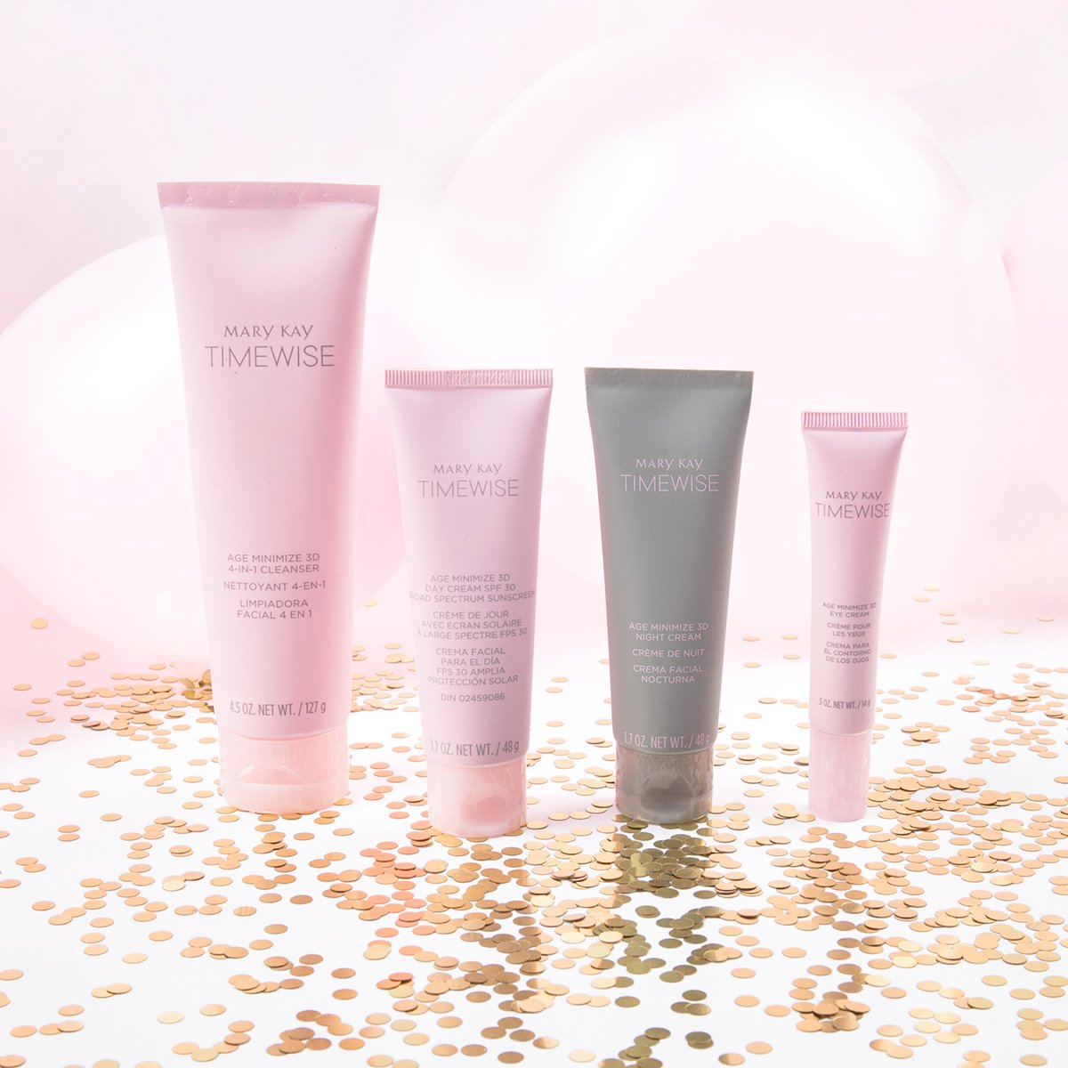 Mary Kay Timewise 3D cleanser, Day Cream, Night Cream and Eye Cream on top of rose gold confetti with pink balloons in the background.