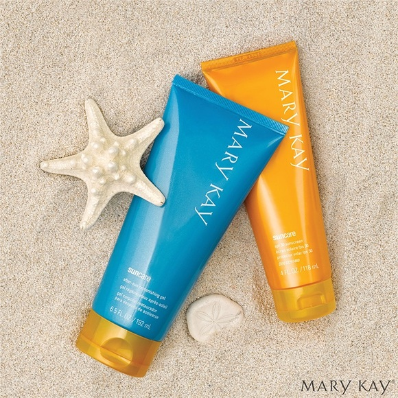 Mary Kay Sunscreen and Mary Kay replenishing gel in the sand with a sand dollar and star fish